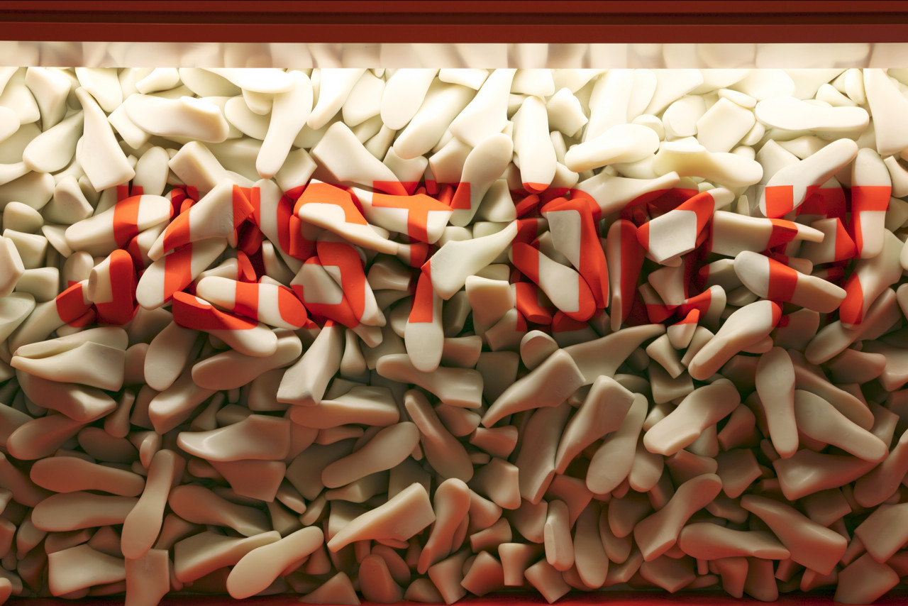 bfe6385135e24b (1F) Close-up of the installation made of the molds of the sneakers behind  the counter